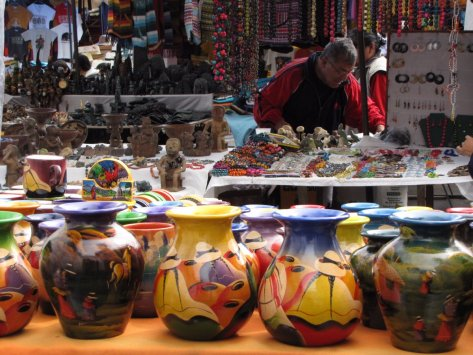 go-shopping-in-otavalo-ecuador-where-rainbows-of-textiles-scarves-wall-displays-hand-bags-and-sweaters-can-be-bought