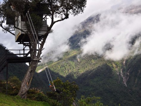 take-a-ride-on-the-swing-at-the-end-of-the-world-at-the-casa-de-arbol-in-ecuador-and-catch-stunning-views-of-the-tungurahua-volcano